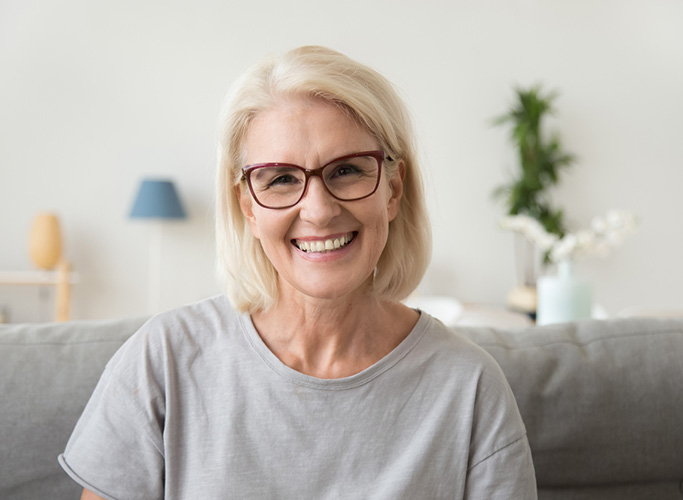Smiling middle-aged mature grey haired woman